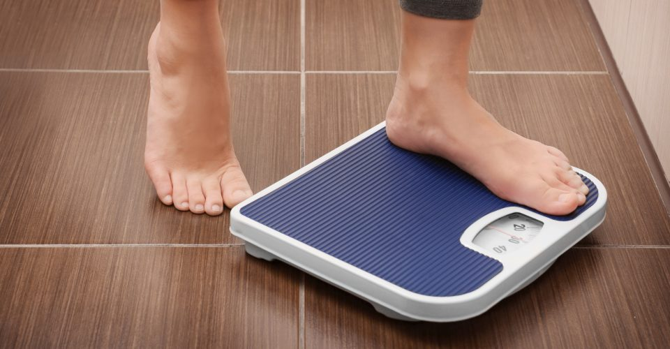 Person stepping onto a scale