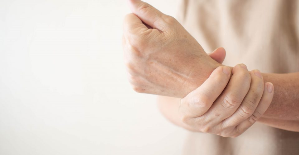 Woman holding wrist with pain