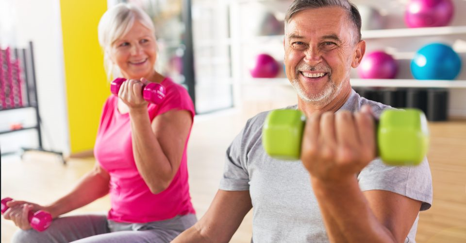 older couple exercising in gym
