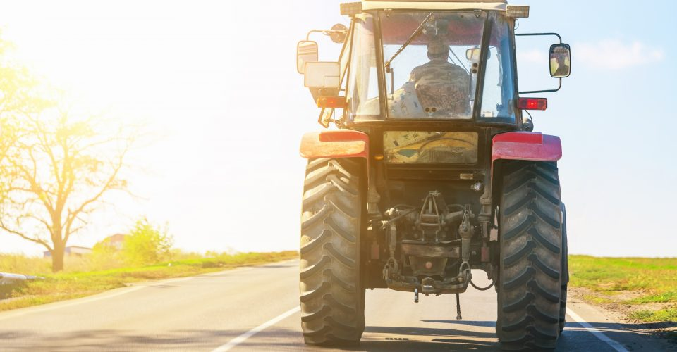 Man driving a tractor on a road