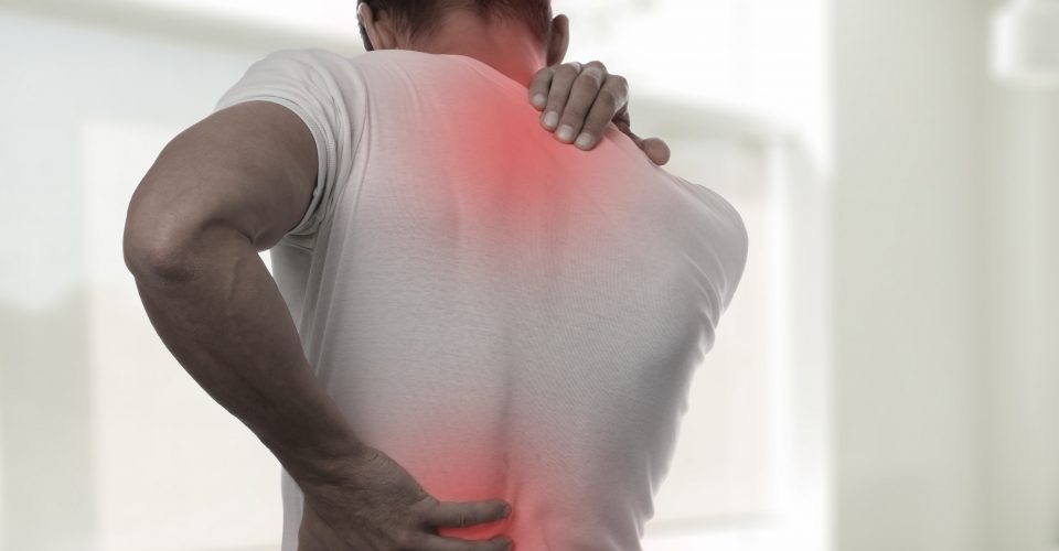 Man holding back in pain